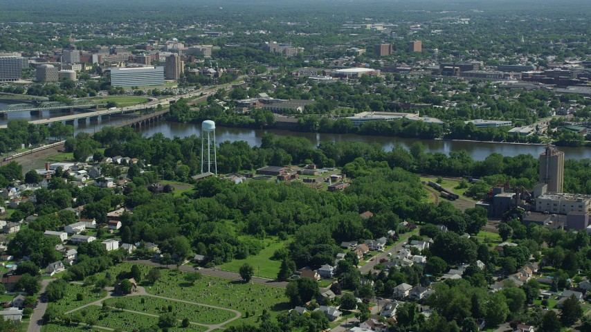 5K stock footage aerial video approaching the Delaware River, with Trenton, New Jersey on the other side Aerial Stock Footage | AX82_059