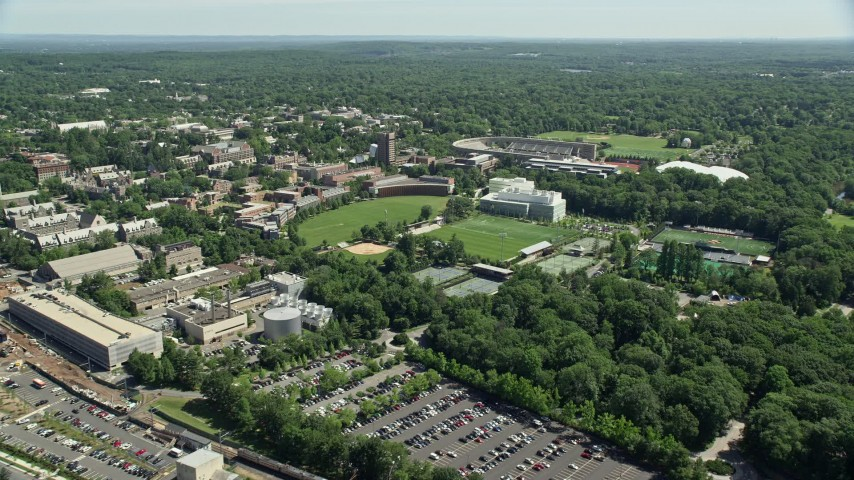 5K aerial video of Roberts Stadium and sports fields on the Princeton University campus, New Jersey Aerial Stock Footage | AX82_092