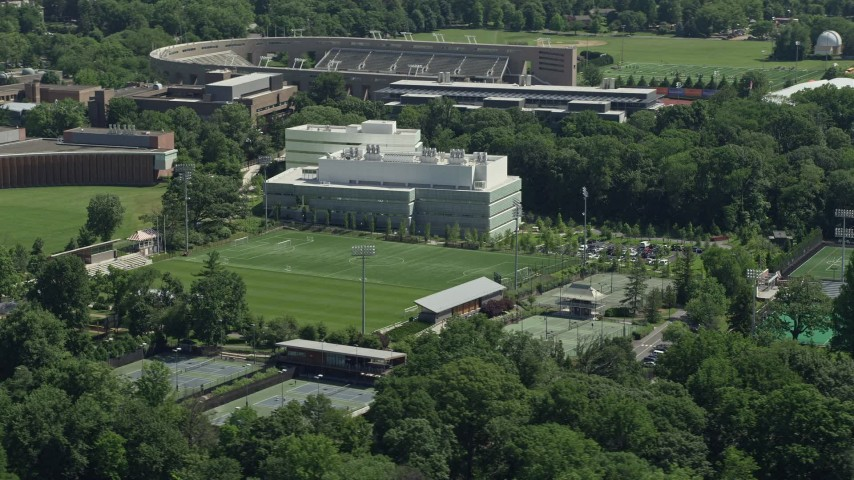 5K stock footage aerial video of Roberts Stadium and Peretsman Scully Hall at Princeton University, New Jersey Aerial Stock Footage | AX82_100