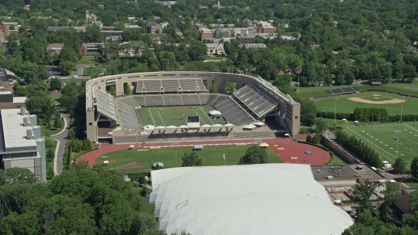 5K stock footage aerial video of football practice at Princeton University Stadium, New Jersey Aerial Stock Footage | AX82_102