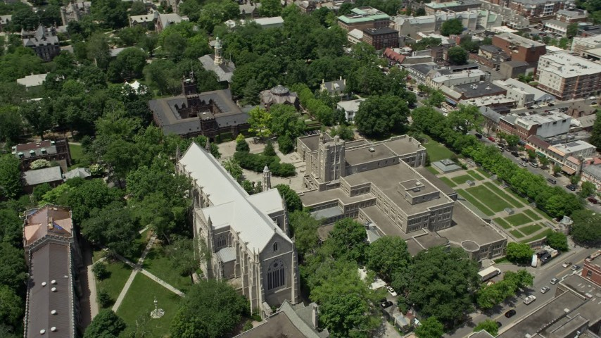 5K stock footage aerial video flying by the Princeton University Chapel, Firestone Library, and campus halls in New Jersey Aerial Stock Footage | AX83_024