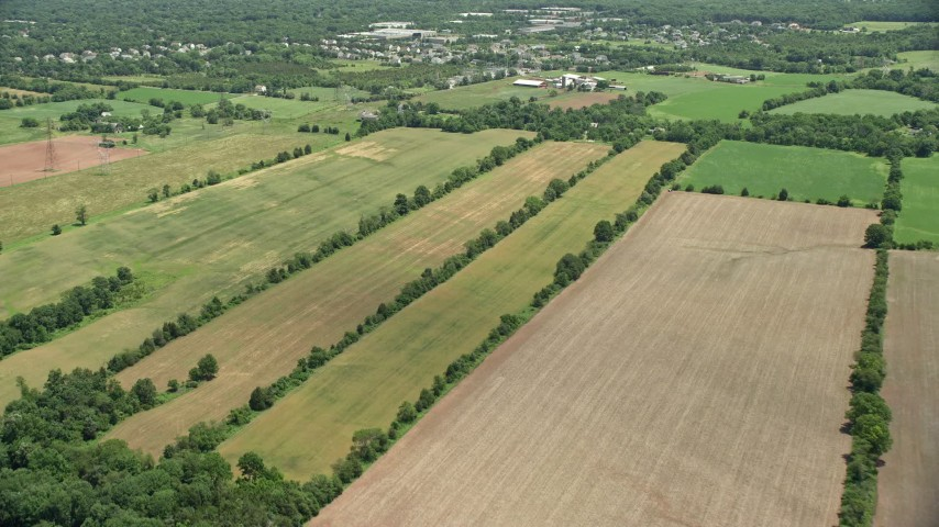 5K stock footage aerial video of farmland near barns in Somerset, New Jersey Aerial Stock Footage | AX83_043
