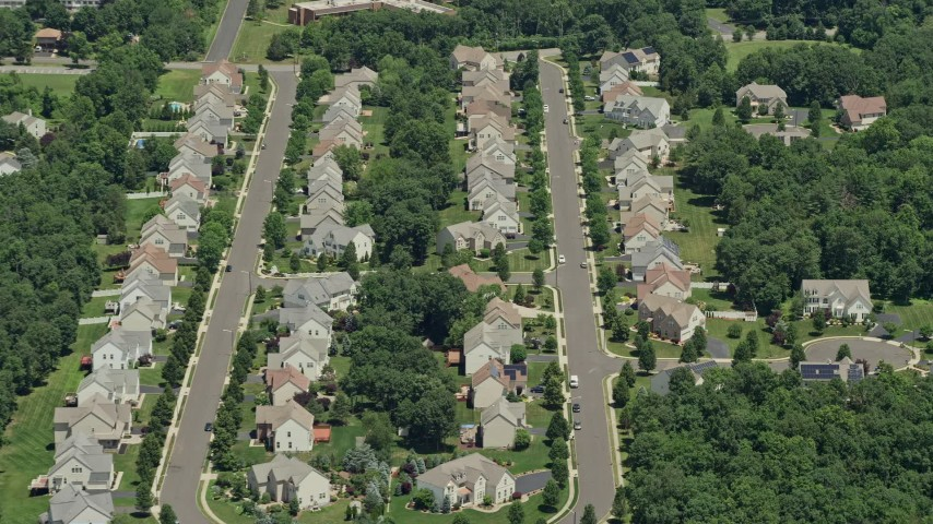 5K stock footage aerial video approaching and flying over upscale homes in Somerset, New Jersey Aerial Stock Footage | AX83_047