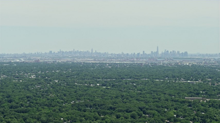 5K stock footage aerial video of a distant view of Lower and Midtown Manhattan, New York seen from New Jersey  Aerial Stock Footage | AX83_062