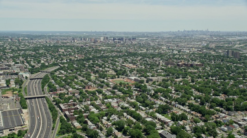 5K stock footage aerial video flying over suburban homes by I-78 to approach Downtown Newark, New Jersey Aerial Stock Footage   AX83_075