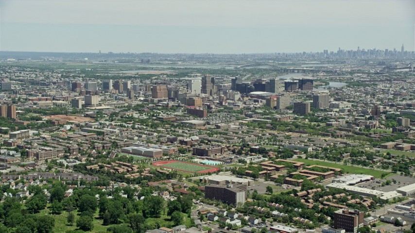 5K stock footage aerial video approaching the Downtown Newark cityscape, New Jersey Aerial Stock Footage | AX83_077