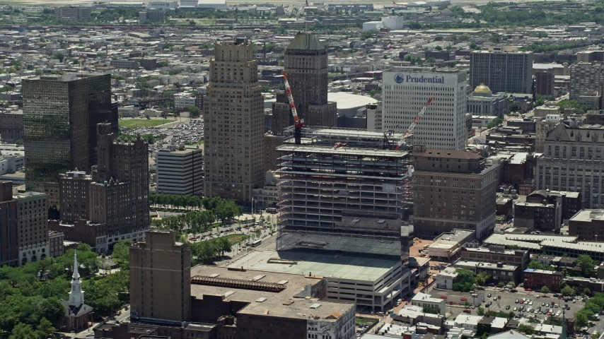5K stock footage aerial video of Downtown skyscrapers and high-rises, Prudential Tower under construction, Newark, New Jersey Aerial Stock Footage | AX83_082