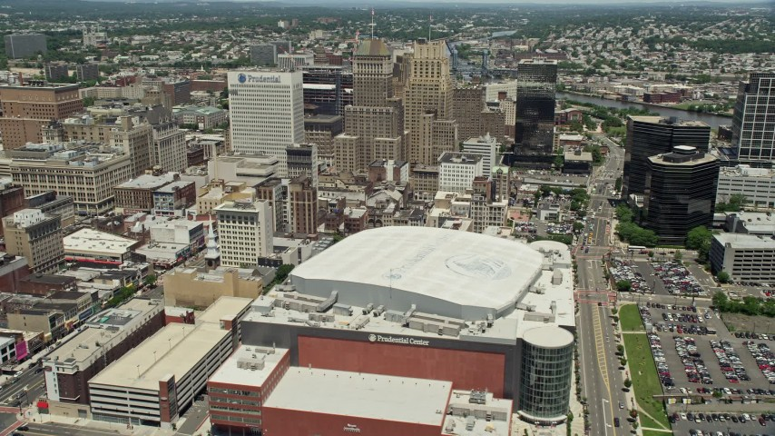 5K stock footage aerial video of tall high-rises seen from Prudential Center in Downtown Newark, New Jersey Aerial Stock Footage | AX83_088