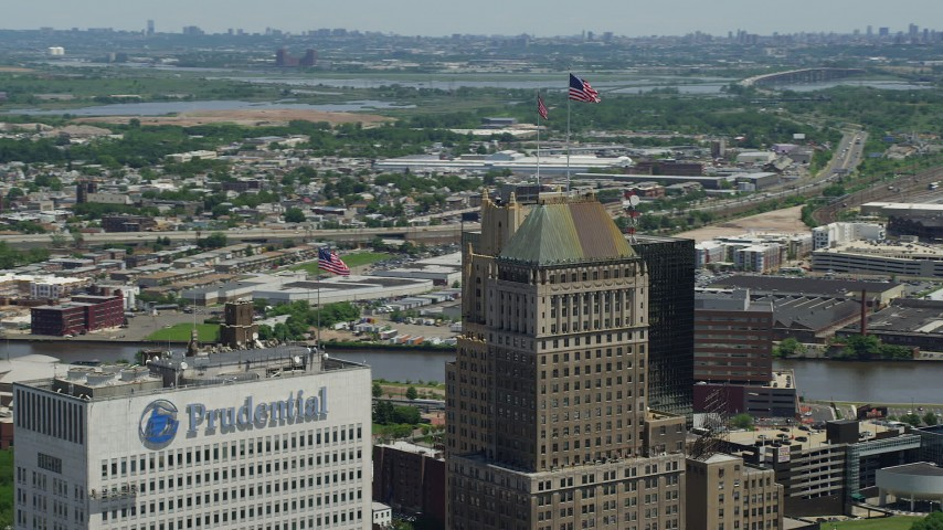 5K stock footage aerial video of flags atop skyscrapers in Downtown Newark, New Jersey Aerial Stock Footage | AX83_089