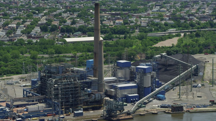 5K aerial video of the Hudson Generating Station power plant in Jersey City, New Jersey Aerial Stock Footage | AX83_104