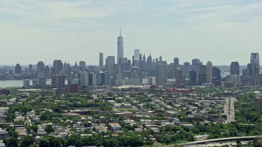 5K aerial video of Lower Manhattan skyline behind Downtown Jersey City, New Jersey & New York Aerial Stock Footage | AX83_105