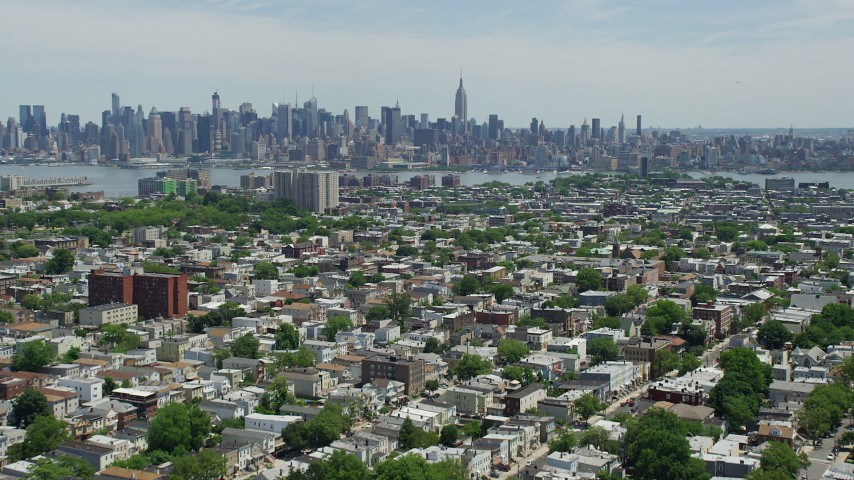 5K stock footage aerial video of Midtown Manhattan and the Hudson River seen from Jersey City neighborhoods, New Jersey & New York Aerial Stock Footage | AX83_107