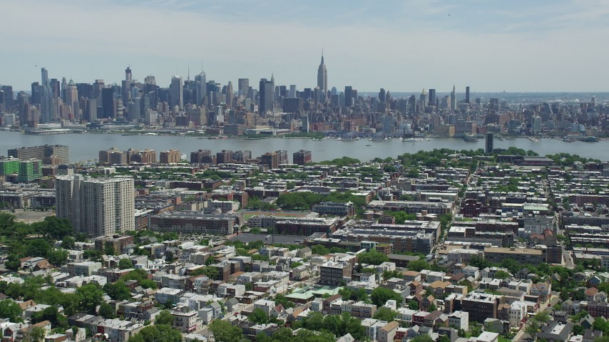 5K stock footage aerial video of Midtown Manhattan skyline and Hudson River seen from Hoboken, New Jersey & New York Aerial Stock Footage AX83_108 | Axiom Images