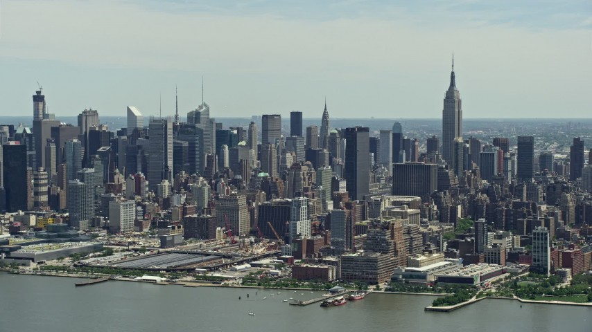 5K stock footage aerial video of West Side Yard, Hudson Yards, and Midtown Manhattan skyscrapers seen from Hudson River, New York City Aerial Stock Footage | AX83_110