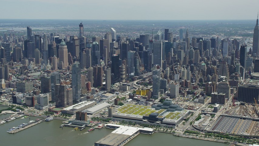 5K stock footage aerial video of Hell's Kitchen and Midtown Manhattan skyscrapers seen from Hudson River, New York City Aerial Stock Footage   AX83_112