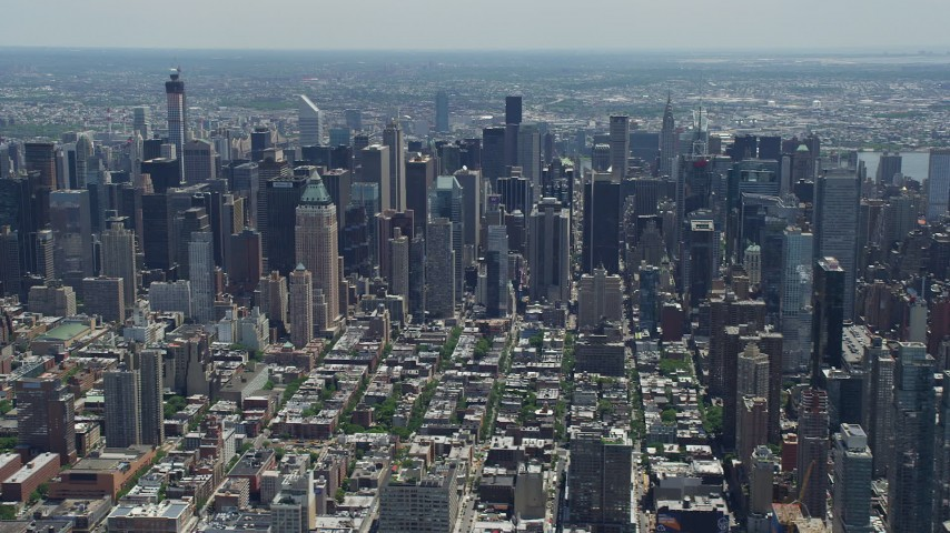 5K stock footage aerial video flying by Midtown Manhattan skyscrapers seen from Hell's Kitchen, New York City Aerial Stock Footage | AX83_114