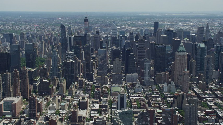 5K stock footage aerial video flying by Midtown and Upper East Side skyscrapers and Central Park, New York City Aerial Stock Footage | AX83_115