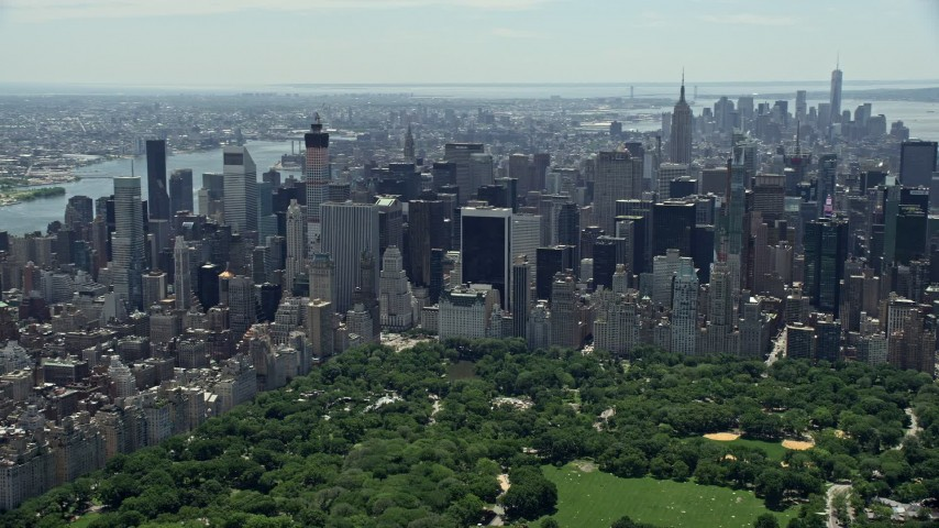 5K stock footage aerial video of Lower and Midtown Manhattan skyscrapers seen from Central Park, New York City Aerial Stock Footage | AX83_118