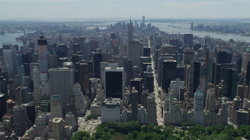 5K stock footage aerial video flying over Midtown Manhattan skyscrapers to approach the Empire State Building, New York City Aerial Stock Footage | AX83_119
