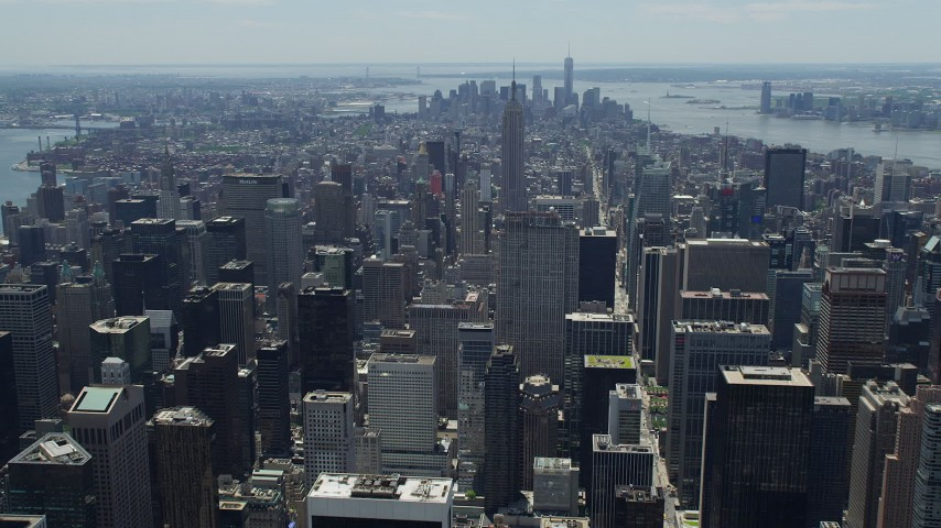 5K stock footage aerial video approaching Empire State Building and Lower Manhattan skyscrapers, New York City Aerial Stock Footage | AX83_120