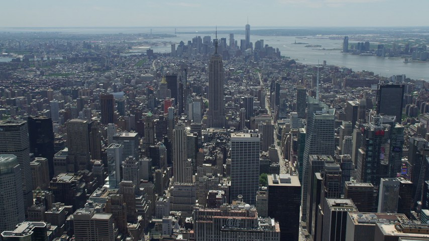 5K stock footage aerial video of Empire State Building and Lower Manhattan skyscrapers, New York City Aerial Stock Footage | AX83_121