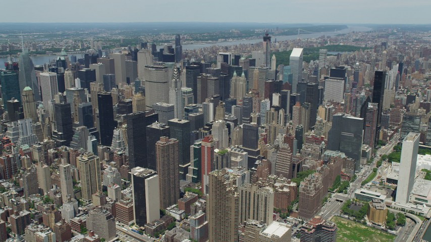 5K stock footage aerial video Chrysler Buildings surrounded by Midtown Manhattan skyscrapers, New York City Aerial Stock Footage | AX83_128