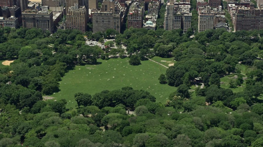 5K stock footage aerial video of Sheep Meadow in Central Park, New York City Aerial Stock Footage | AX83_133