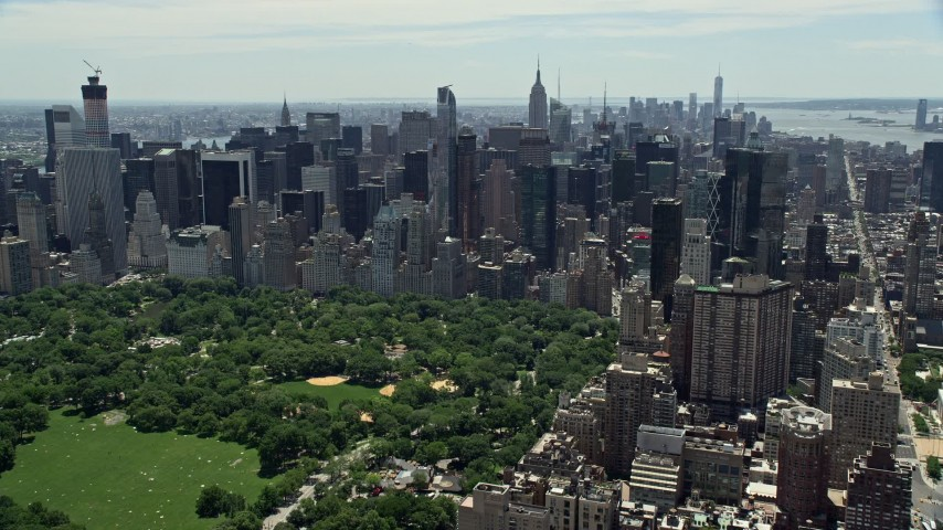 5K stock footage aerial video approaching Midtown Manhattan from Central Park, New York City Aerial Stock Footage | AX83_139