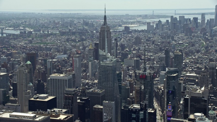 5K stock footage aerial video approaching Empire State Building and Bank of America Tower, Midtown Manhattan, New York City Aerial Stock Footage | AX83_142