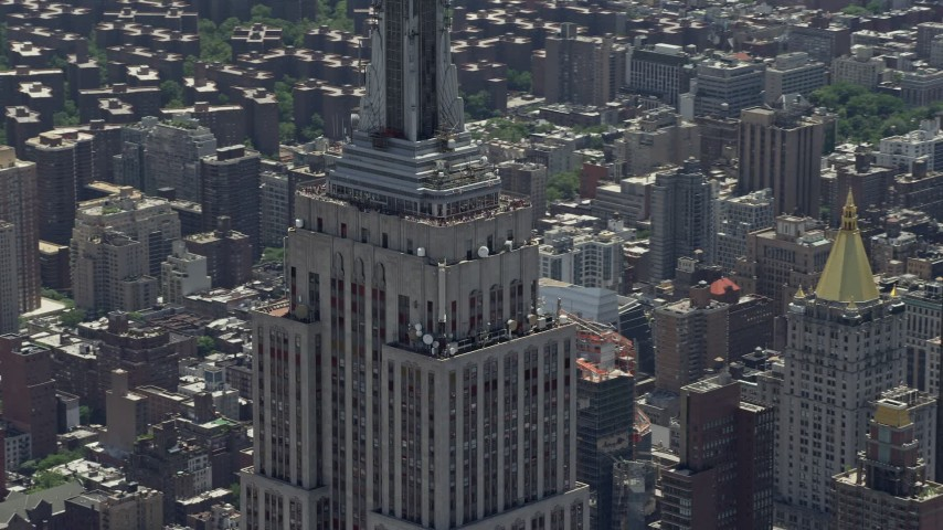5K stock footage aerial video of upper levels of the Empire State Building, Midtown Manhattan, New York City Aerial Stock Footage | AX83_145