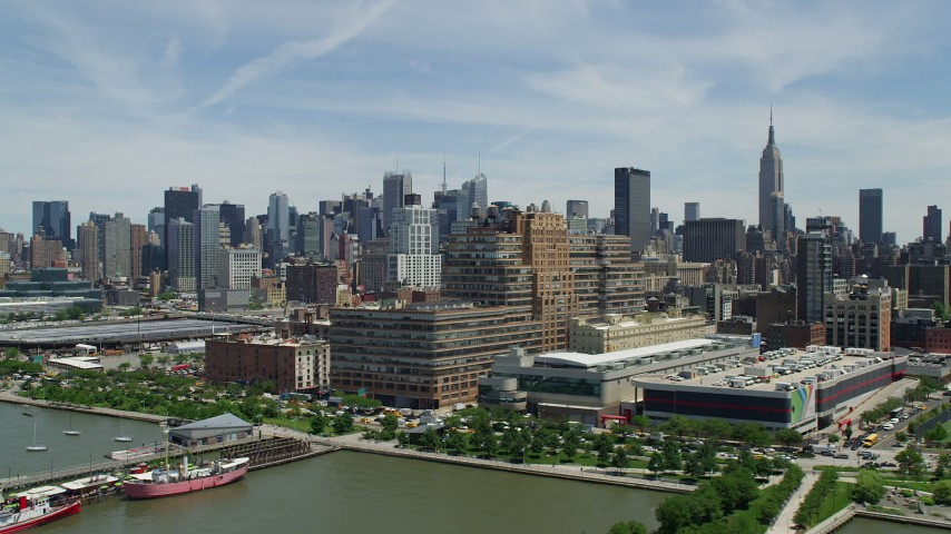 5K stock footage aerial video flying by Starrett-Lehigh Building and Hudson Yards, with a view of Midtown Manhattan skyscrapers, New York City Aerial Stock Footage | AX83_151