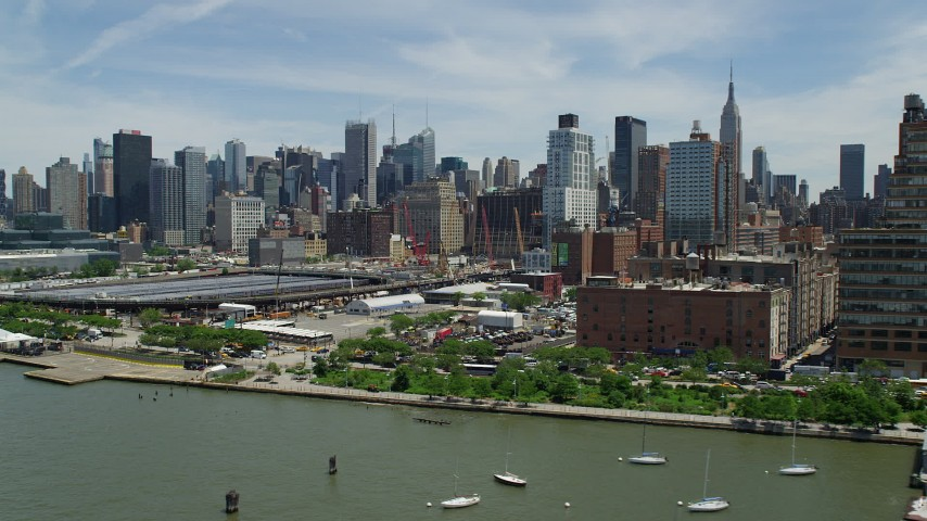5K stock footage aerial video of Midtown Manhattan while landing on a heliport by Hudson Yards in New York City Aerial Stock Footage | AX83_152