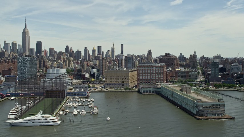 5K stock footage aerial video panning across piers and riverfront apartment buildings, Chelsea and Greenwich Village, New York City Aerial Stock Footage | AX83_154