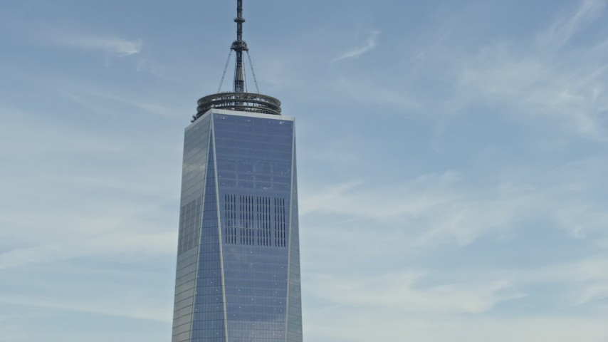 5K stock footage aerial video of the top of One World Trade Center, Lower Manhattan, New York City Aerial Stock Footage | AX83_159