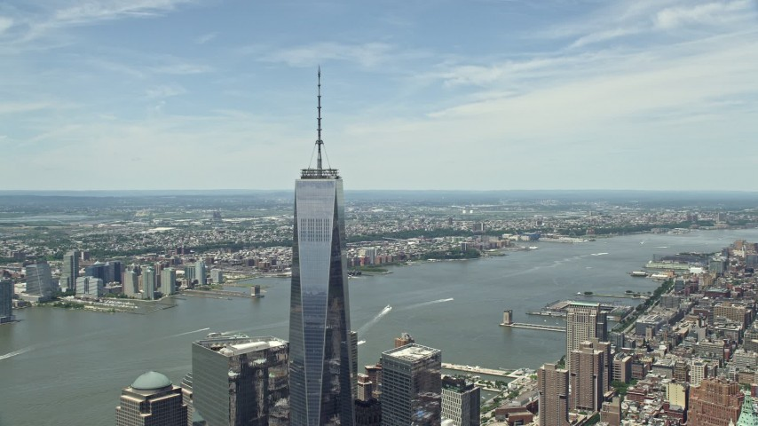 5K stock footage aerial video of One World Trade Center tilt down to reveal World Trade Center Memorial, Lower Manhattan, New York City Aerial Stock Footage   AX83_163