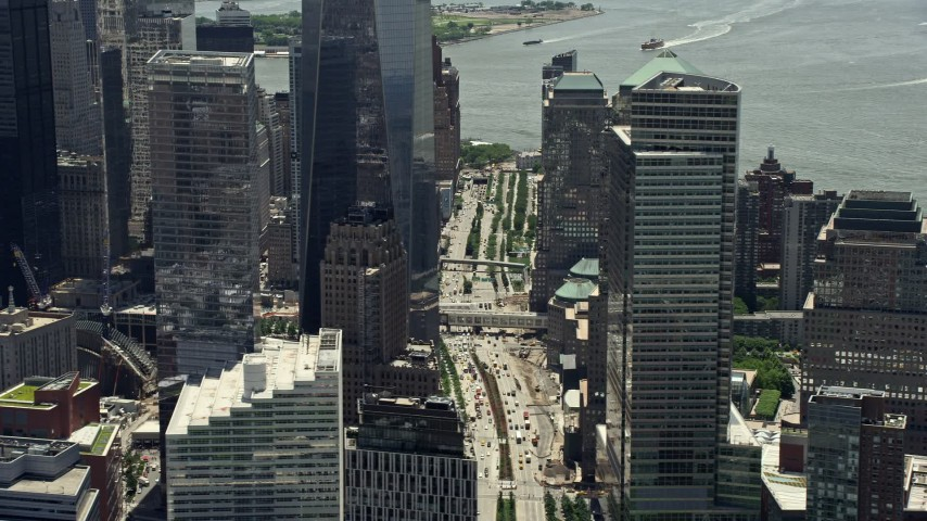 5K stock footage aerial video of the base of One World Trade Center and streets, Lower Manhattan, New York City Aerial Stock Footage | AX83_166