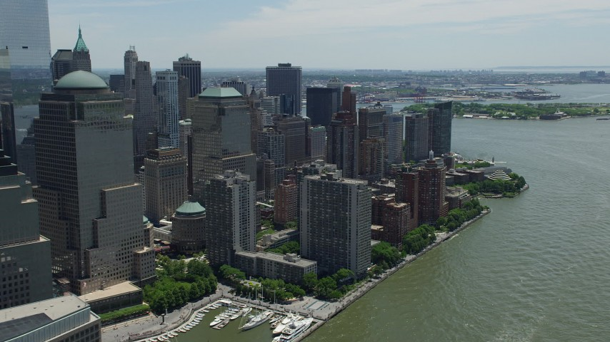 5K stock footage aerial video of Lower Manhattan skyscrapers seen from the Hudson River, New York City Aerial Stock Footage | AX83_168