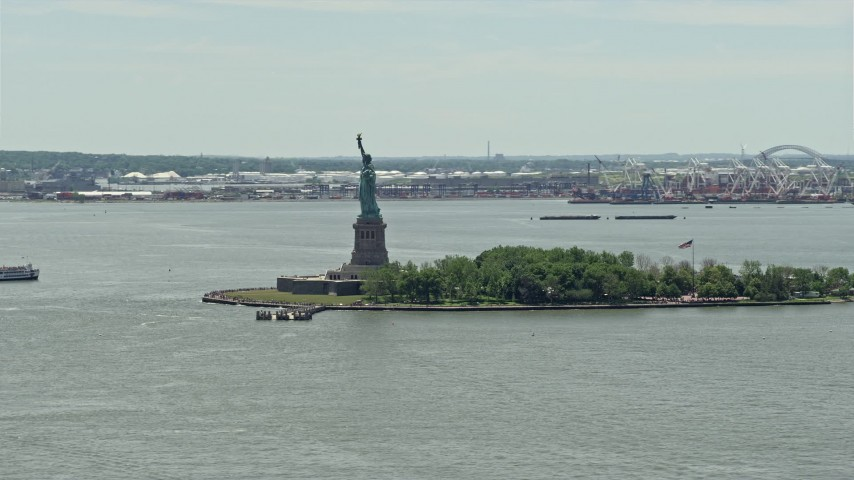 5K stock footage aerial video orbiting Statue of Liberty in New York Harbor, New York City Aerial Stock Footage | AX83_174
