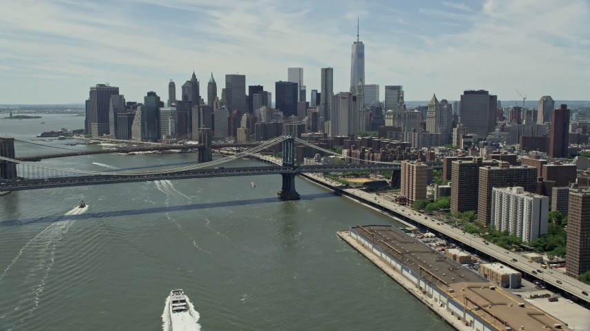 5K stock footage aerial video of Brooklyn and Manhattan Bridges, and the Lower Manhattan skyline, New York City Aerial Stock Footage | AX83_182