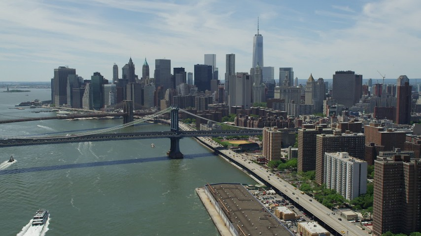 5K aerial video approaching the Brooklyn and Manhattan Bridges, and the Lower Manhattan skyline, New York City Aerial Stock Footage | AX83_183