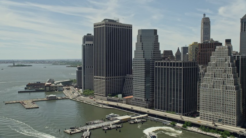 5K stock footage aerial video of skyscrapers along the East River, Lower Manhattan, New York City Aerial Stock Footage | AX83_189
