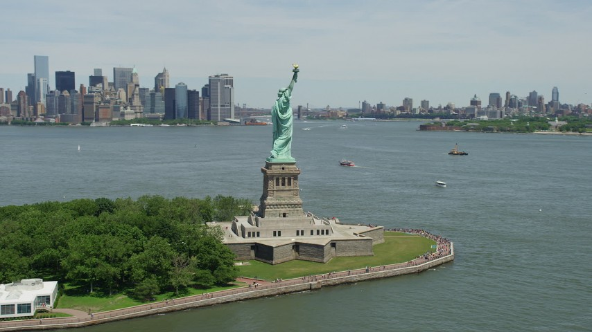 5K stock footage aerial video of Statue of Liberty with Brooklyn in the distance, New York  Aerial Stock Footage | AX83_195