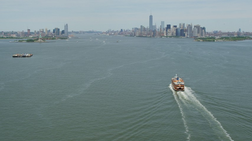 5K stock footage aerial video tilting from Staten Island Ferry on New York Harbor,reveal Jersey City and Lower Manhattan skylines, New York & New Jersey Aerial Stock Footage   AX83_201