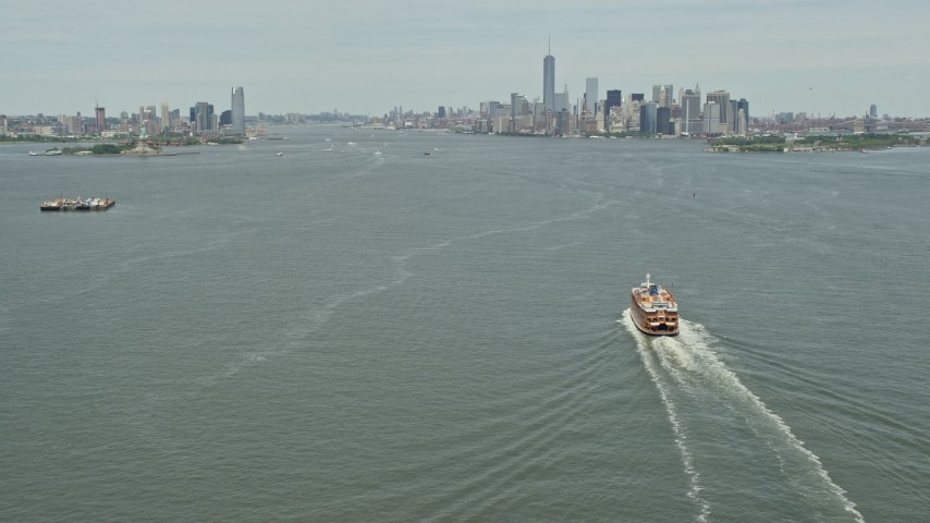 5K stock footage aerial video tilting from Staten Island Ferry on New York Harbor,reveal Jersey City and Lower Manhattan skylines, New York & New Jersey Aerial Stock Footage | AX83_201E