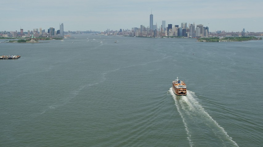 5K aerial video of Staten Island Ferry on New York Harbor, and Jersey City and Lower Manhattan skylines, New York & New Jersey Aerial Stock Footage | AX83_202
