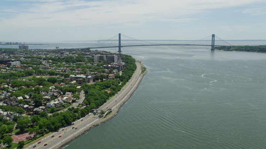 5K stock footage aerial video following Shore Parkway to approach Verrazano-Narrows Bridge, New York Harbor Aerial Stock Footage | AX83_205