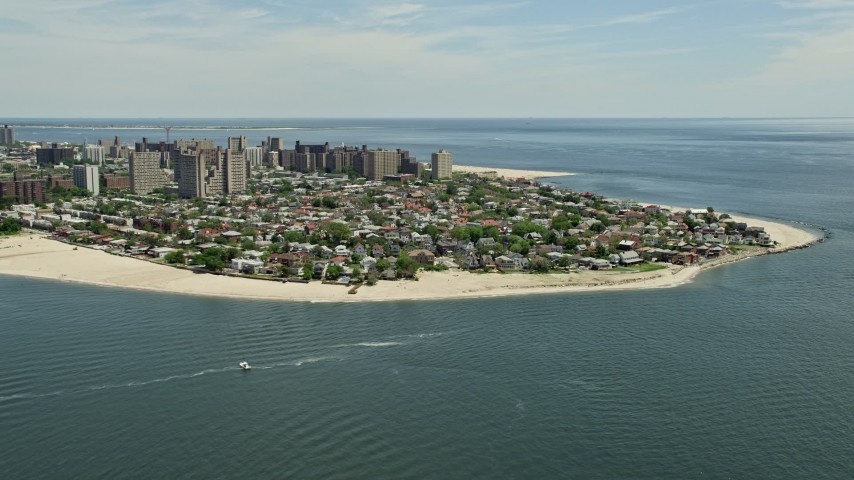 5K stock footage aerial video flying by Coney Island neighborhoods and beaches, Brooklyn, New York City Aerial Stock Footage | AX83_210