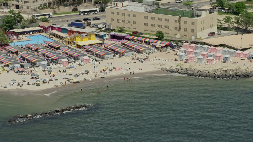 5K stock footage aerial video of beach goers on Coney Island Beach, Brooklyn, New York City Aerial Stock Footage | AX83_211