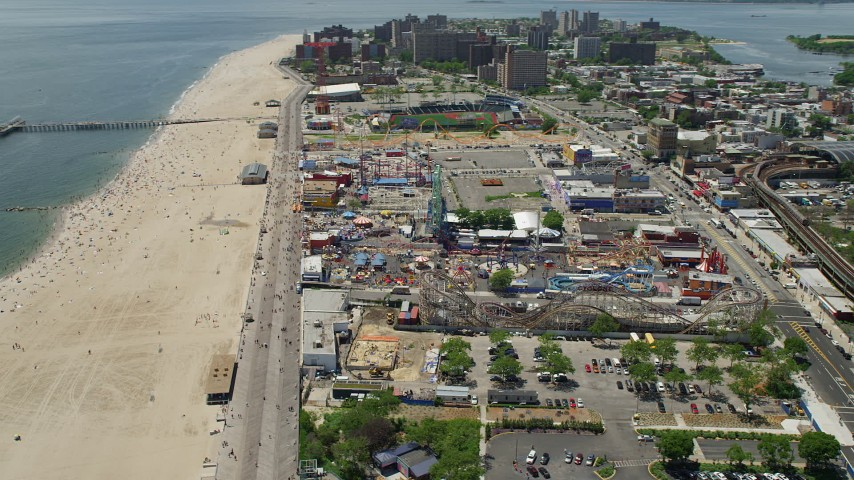 5K aerial video orbiting Coney Island Beach, Riegelmann Boardwalk, and Luna Park, Brooklyn, New York City Aerial Stock Footage | AX83_216