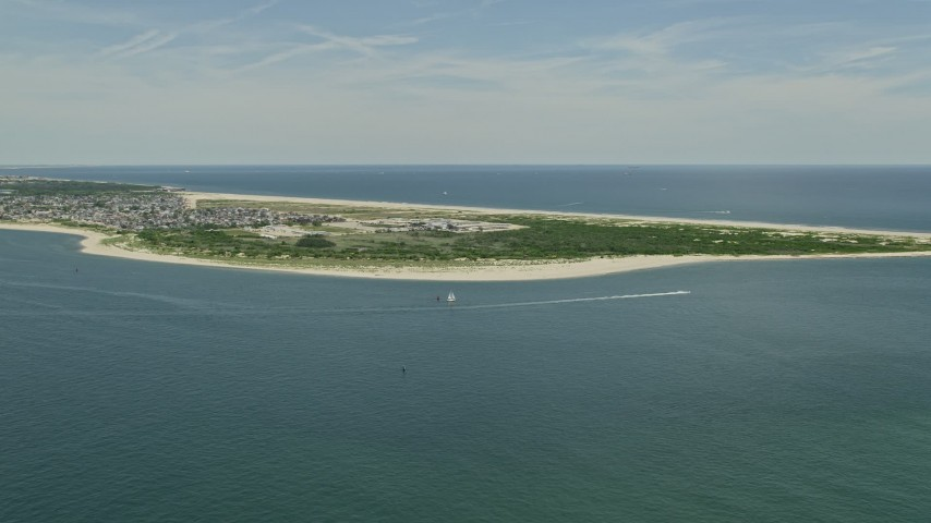 5K stock footage aerial video approaching the beach at Breezy Point, Queens, New York Aerial Stock Footage | AX83_222